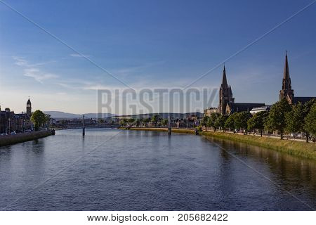 Beautiful dusk view of Panorama of Inverness looking downstream to the Greig St Bridge with Huntly Street on the left, the River Ness cutting between and Bank Street on the right.