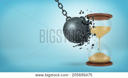3d rendering of a large black iron wrecking ball breaks when collides with a retro hourglass on blue background. Time conquers all. Time management. Missing time opportunity.