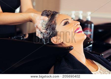 Portrait of women which wash hair in a beauty salon