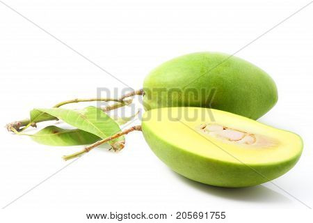 Green mango with leaves isolated on a white background
