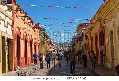 December 17 2014 San Cristobal de las Casas Mexico: walking the narrow colonial streets in the main area of the historic centre closed off from vehicle traffic a favoutrite activity with visitors