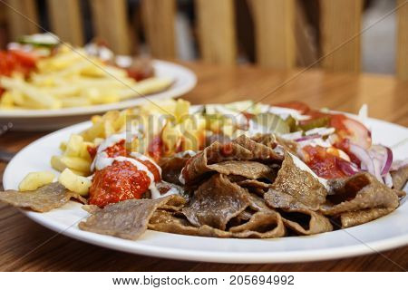 Strips Of Fried Meat With Fried Potatoes And Ketchup