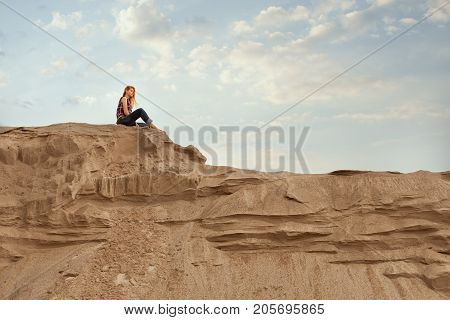 Woman sits high on the mountain and is plunged into dreams she thinks.