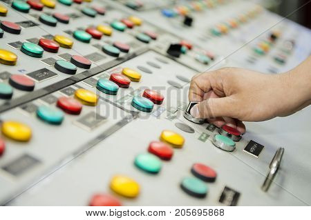 Hand of control panel board. Colorful of control panel board.