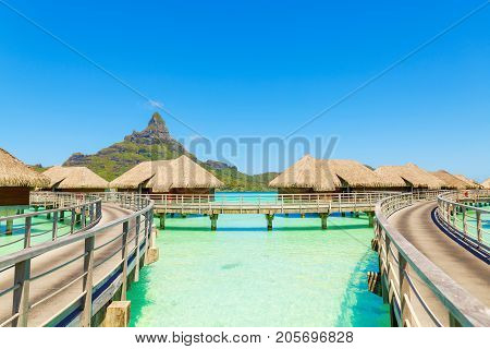 Over water villas on a tropical lagoon of Bora Bora Island Tahiti French Polynesia