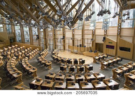 Edinburgh, Scotland, UK: May 27, 2016: The Debating Chamber of the Scottish Parliament in Edinburgh. The building was designed by Spanish Catalan architect Enriq Miralles and opened in 2004.