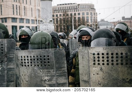Minsk Belarus - March 25 2017 - Special police unit with shields against protesters. Belarusian people participate in the protest against the decree 3 Lukashenko and the current authorities.