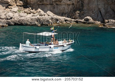 CAPRI ITALY - JUNE 13 2017: Boats with tourists near Grotta Bianca and Grotta Meravigliosa Capri iATLY