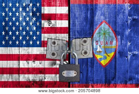 US and Guam flag on door with padlock