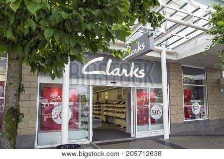 Swansea, UK: July 09, 2017: A Clarks shoe store. Clarks is an international shoe manufacturer based in Somerset, England