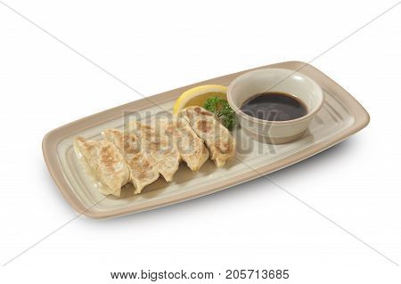 Isolated and clipping path of Japanese gyoza with soy sauce.