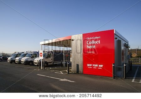 Swansea, UK: December 28, 2016: Tesco Click and Collect, order shopping online and collect from a local store for free. Delivery vans are parked alongside