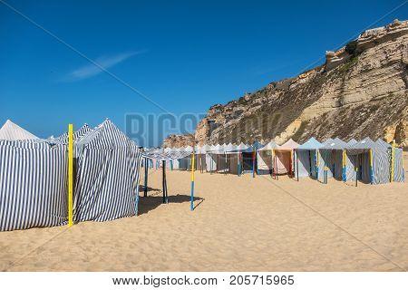 Seasonal canvas tents on the beach. Nazare Estremadura Region Portugal