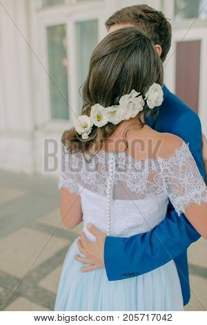 man with a girl in a wedding dress