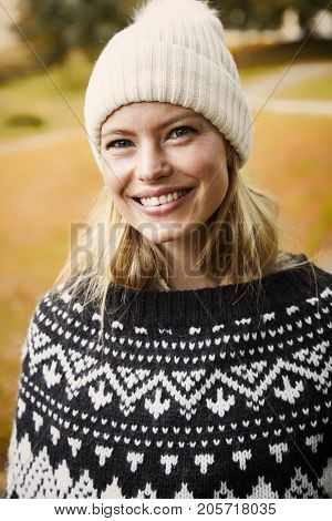 Beautiful smiling woman in woolly hat portrait