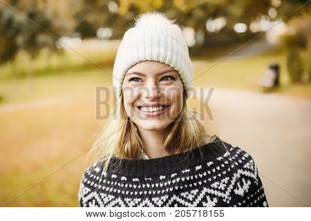 Woolly hat girl with long blond hair smiling