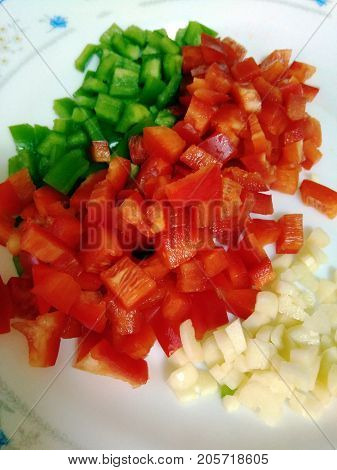 Tomato, pepper and garlic chopped to make the meal