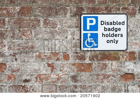 Disabled Parking Space Plate On Brick Wall