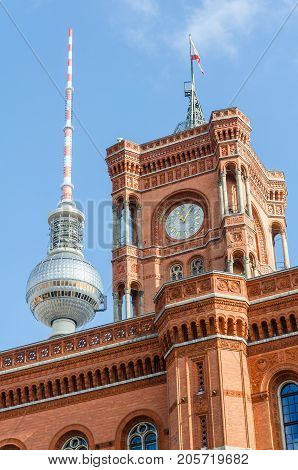 berlin red town hall and television tower with blue sky