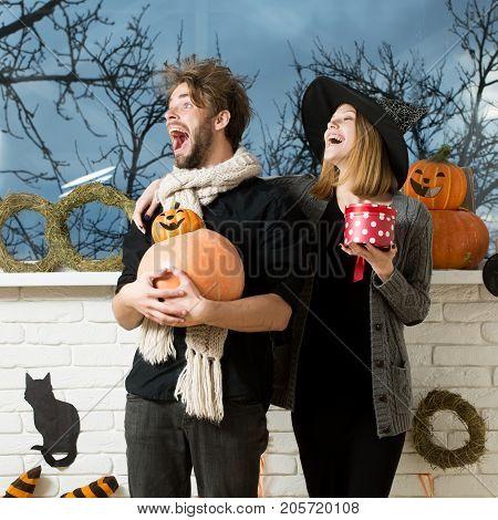 Halloween Man In Scarf Holding Pumpkins
