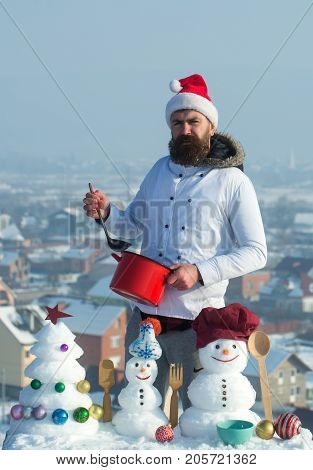 Hipster Holding Ladle And Red Pot