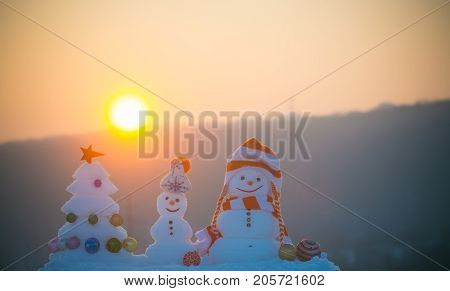 Snow Sculptures On Sunset Sky Background