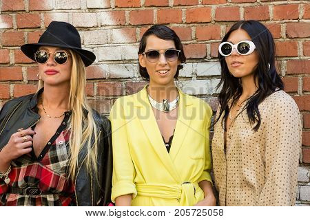 MILAN ITALY - SEPTEMBER 21: Fashionable women poses outside Fendi fashion show building during Milan Women's Fashion Week on SEPTEMBER 21 2017 in Milan.