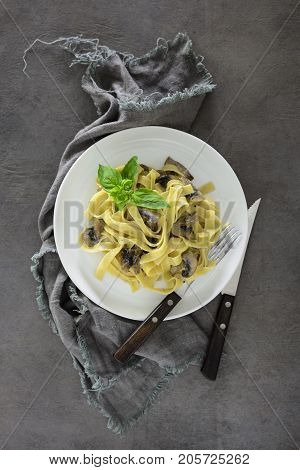 Tagliatelle with mushroom creamy sauce view from above