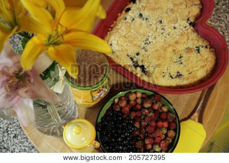Home made cheese cake, flowers and berries