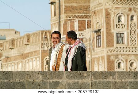 Two Man With Traditional Clothes Walking On The Street