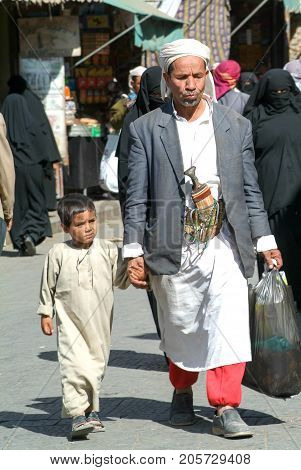 Man With A Boy On Traditional Clothes At Sana On Yemen