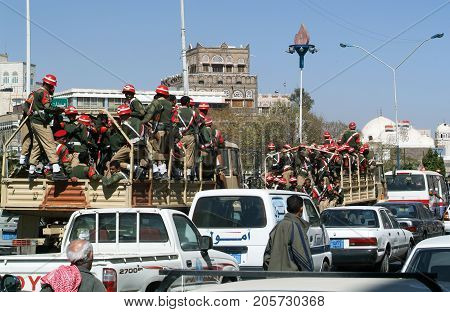 Soldiers Sitting On Military Trucks On The Streets Of Sana