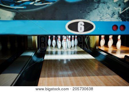 Close Up Of Ten Pins At Bowling Club.