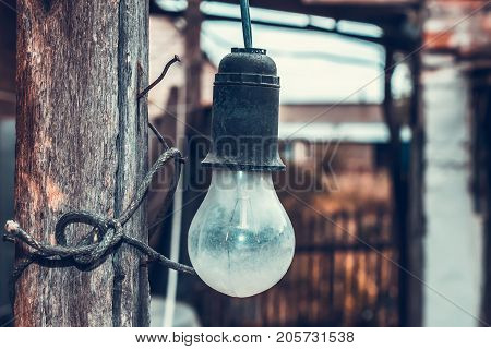 Bulb on wooden pillar vintage old retro background