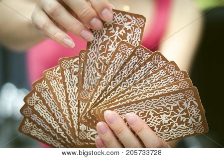 Fortune teller female hands and tarot cards. Divination concept.