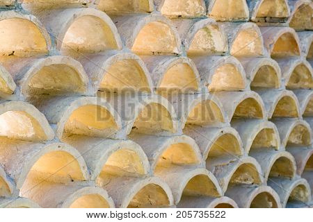 Repetition of small arches made of concrete used as building wall decoration