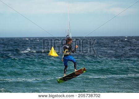 January 25 2014 Los Barriles Mexico: kiteboarder lifts off rough water at the 'Lord of the Wind' kite surf competition