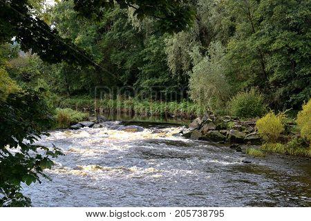 Autumnal river scene in Ayrshire Scotland UK
