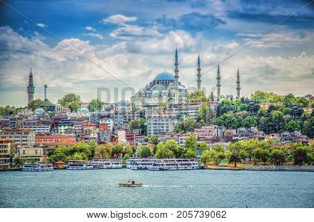 ISTANBUL TURKEY - MAY 1 2017: View of the Suleymaniye Mosque and fishing boats in Eminonu Istanbul Turkey