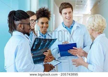 Medical Interns Listening To Teacher