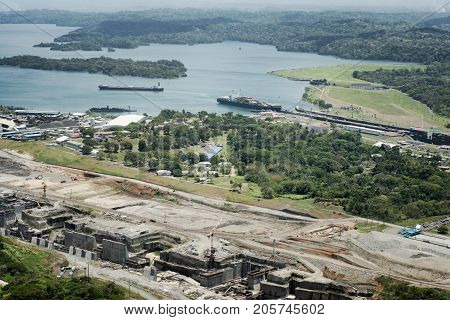 Aerial view of cargo ships at Gatun Locks and the new larger set of locks in construction next to it.