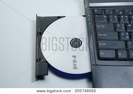 The Dvd Disc In Tray Of Notebook Computer