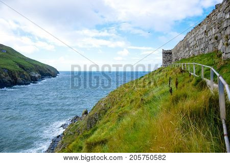 Isle of Man coastline landscape, hills and mountain covered with green grass, Douglas, Isle of Man