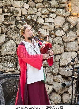 Jerusalem Israel September 23 2017 : The musician plays on bagpipes at the festival