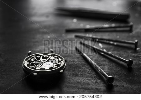 Watchmaker is repairing the mechanical watches in his workshop