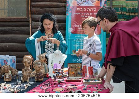 Jerusalem Israel September 23 2017 : The craftsman shows how to make a chain at the festival