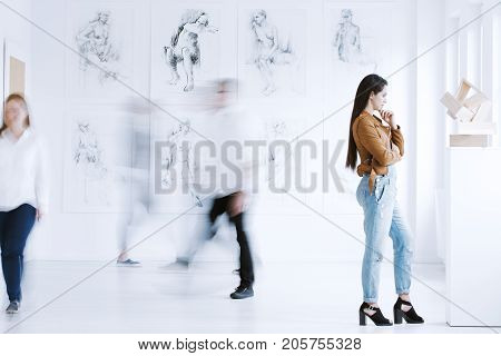 Young Woman Observing Sculpture