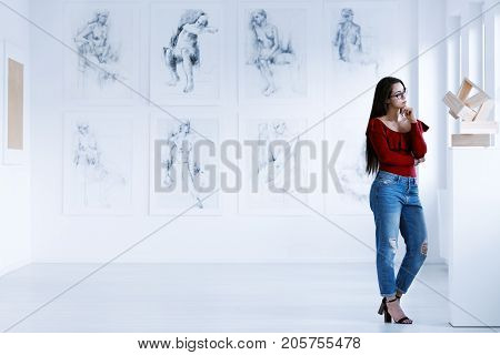 Woman Observing Contemporary Sculpture