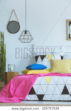 Pink Coverlet In Colorful Bedroom