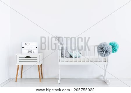 White Cradle With Pastel Pompons